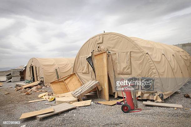 Debris is piled up around abandoned tents in an area on Forward Operating Base Shank that is no longer used on April 3 2014 near Pule Alam...