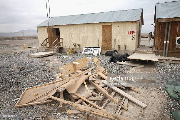 Debris is piled up around an abandoned building in an area on Forward Operating Base Shank that due to a shrinking population on the FOB is no longer...