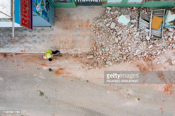 TOPSHOT Debris is removed from collapsed buildings in Guanica Puerto Rico on January 8 one day after the earthquake Puerto Rico's governor declared a...