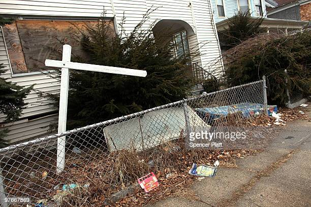 Debris is scattered around an abandoned property on March 12 2010 in Bridgeport Connecticut A new report by RealtyTrac Inc announced that the number...