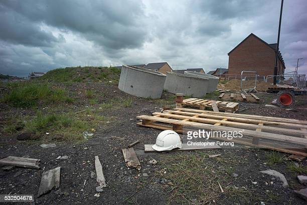 Debris is scattered around the reclaimed land of the former Orgreave Coking plant which has now been redeveloped for modern housing as the coking...