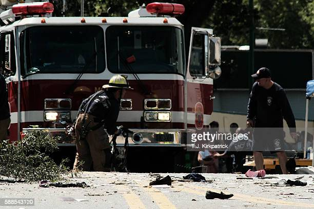 Debris is scattered in the street at the site of an overnight explosion and fire that destroyed an apartment building in the Flower Branch Apartments...