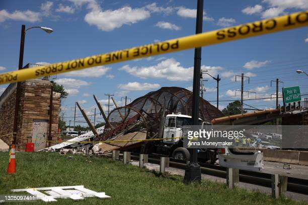 Debris is seen after a pedestrian bridge collapsed on June 23, 2021 in Washington, DC. At least six people were reportedly injured on Wednesday when...