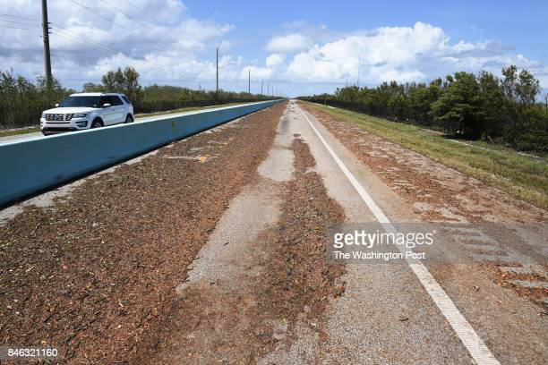 Debris is seen along the Florida Keys Oversees Highway following Hurricane Irma on Tuesday September 12 2017 in Key Largo FL