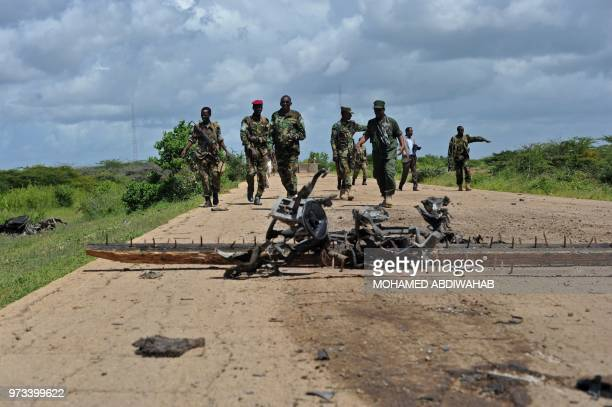 Debris is seen at a check point as Somali soldiers patrol near Sanguuni military base where an American special operations soldier was killed by a...