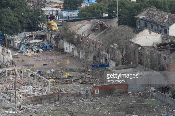Debris is seen at the site after a blast in Jiangbei District on November 26 2017 in Ningbo Zhejiang Province of China The explosion happened at...