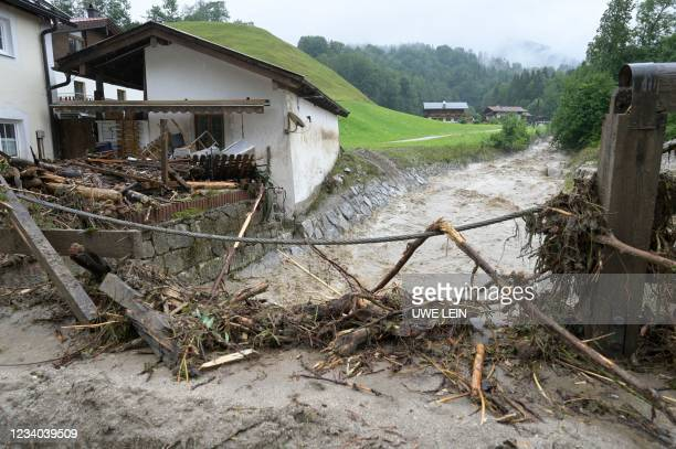 Debris is seen in front of a house near a river, after heavy rainfall and flood caused major damage in Berchtesgaden, South eastern Bavaria, Germany,...