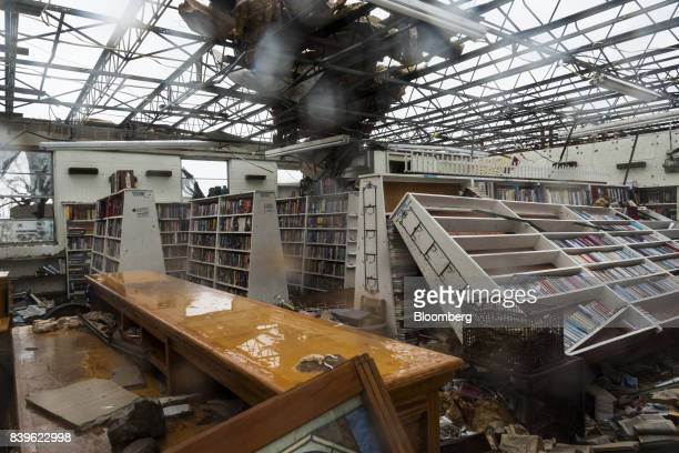 Debris is seen inside of a damaged bookstore after Hurricane Harvey hit Rockport Texas US on Saturday Aug 26 2017 As Harvey's winds die down trouble...