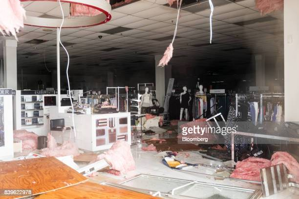 Debris is seen inside of a damaged business after Hurricane Harvey hit Rockport Texas US on Saturday Aug 26 2017 As Harvey's winds die down trouble...