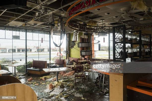 Debris is seen inside of a damaged Popeye's Louisiana Kitchen Inc after Hurricane Harvey hit Rockport Texas US on Saturday Aug 26 2017 As Harvey's...
