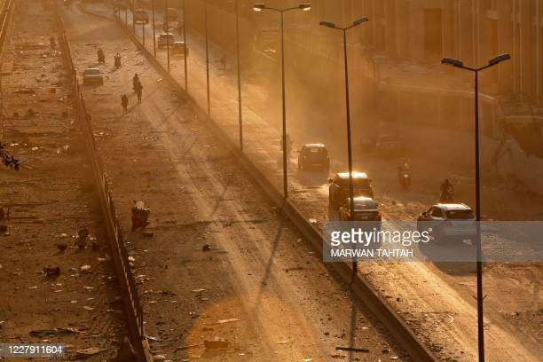TOPSHOT Debris is seen on a main road in Beirut at sunset following a twin explosion that shook the port of Lebanon's capital on August 4 2020 Two...