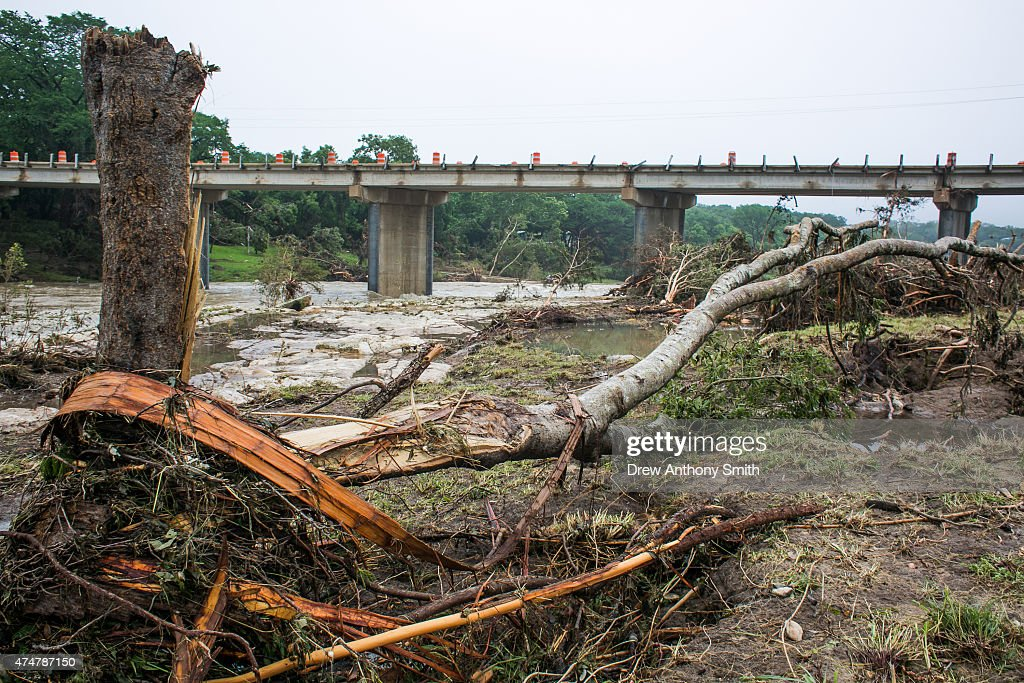 Debris is strewn along Ranch Road 12 near the Blanco River May 26, 2015 in Wimberley, Texas. Central Texas has been hit with severe weather, including catastrophic flooding and tornadoes over the past several days.