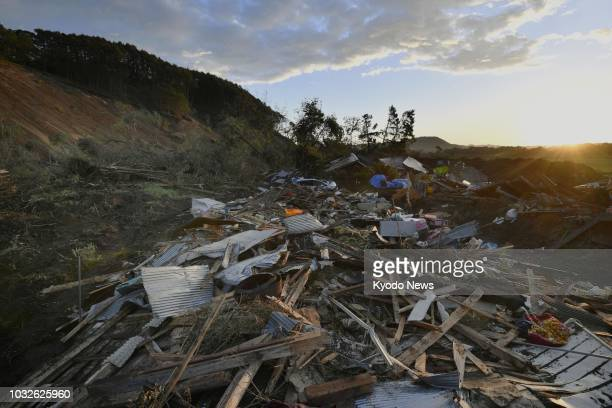 Debris is strewn around a residential area of Atsuma Hokkaido on Sept 13 one week after a landslide triggered by a strong earthquake hit the area...