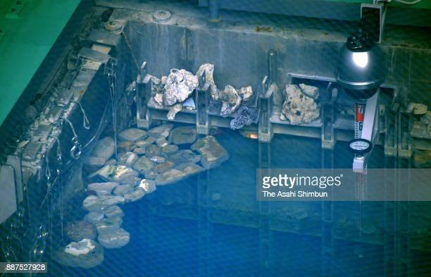 Debris is visible near the surface of the storage pool for spent nuclear fuel near the top of the No 3 reactor building at the Fukushima Daiichi...