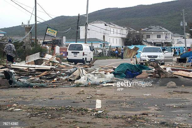 Debris left by Hurricane Dean is seen in the streets 20 August 2007 in Kingston Jamaica Hurricane Dean crept into the northwestern Caribbean Sea...