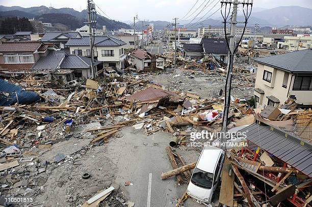 Debris left by the tsunami litters a street in the town of Ofunato in Iwate prefecture on March 14 2011 three days after an 89 magnitude earthquake...