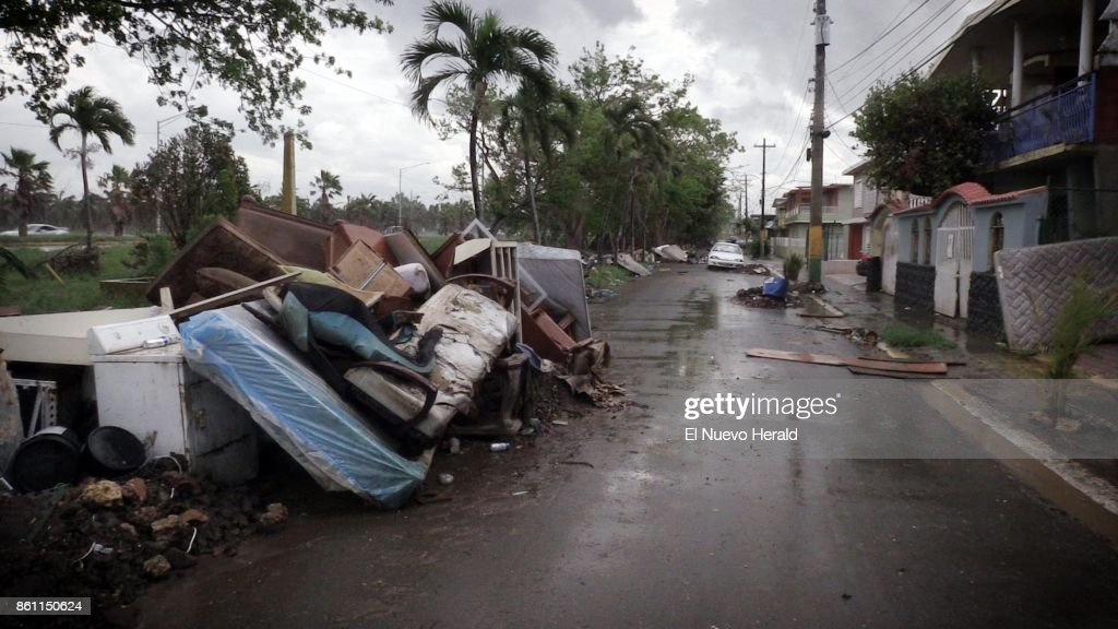 Debris Left Over From Hurricane Maria As Well As Furniture, Appliances And Washed  Out Vehicles