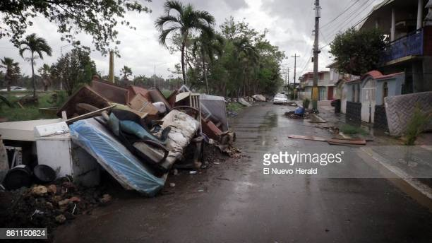 Debris left over from Hurricane Maria as well as furniture appliances and washed out vehicles litter a street in Toa Baja Puerto Rico on October 12...