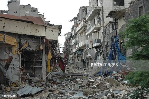 Debris lie on a street near the Faical souk in the old city of Homs on May 8 2014 after Syrian government forces regained control of rebelcontrolled...