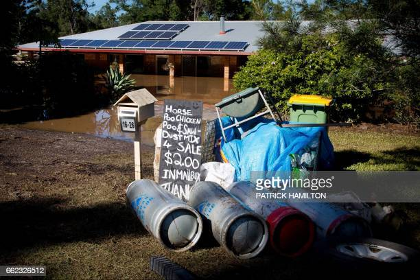 Debris lies abandoned in front of a home partially submerged under floodwaters caused by Cyclone Debbie in North MacLean Brisbane on April 1 2017...