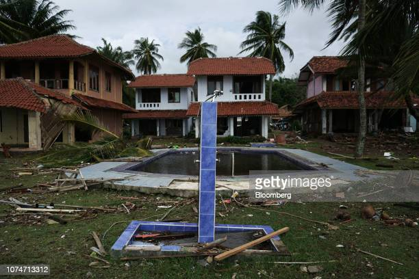 Debris lies around a swimming pool at the Milla House Anyer hotel in Carita Banten province Indonesia on Monday Dec 24 2018 Rescuers hunted for...