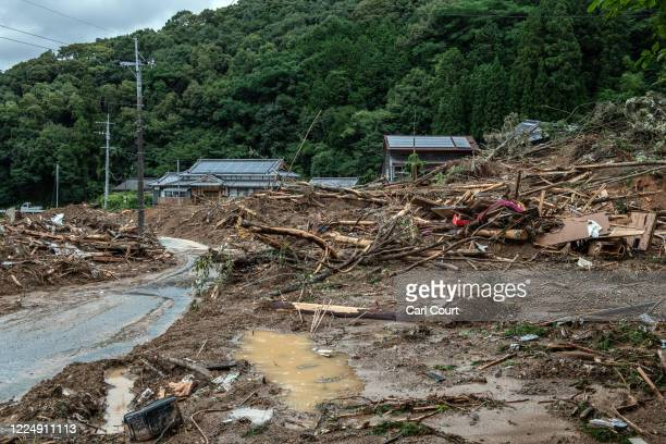 Debris lies in mud after a landslide caused by torrential rain, on July 6, 2020 in Ashikita, Japan. Around 37 people are believed to be dead and many...