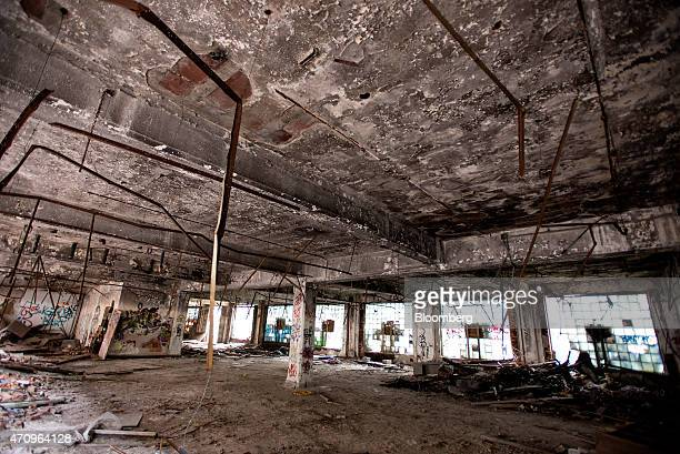 Debris lies on the floor of the administration building of the abandoned Packard auto assembly plant in Detroit Michigan US on Tuesday April 21 2015...
