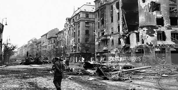 Debris lies strewn across Baross Strasse in the center of the Hungarian capital in the wake of a violent battle between antiCommunist demonstrators...