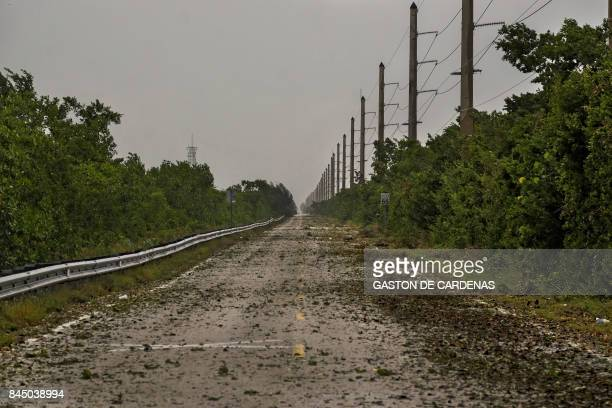 TOPSHOT Debris litter Cardsound Road into the Florida Keys as winds and rain from the outer bands of Hurricane Irma arrive in Key Largo Florida on...