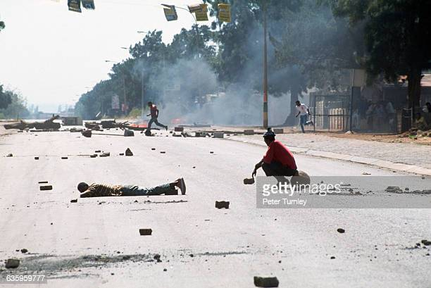 Debris litters a township street after a violent confrontation between supporters of the Inkatha Freedom Party and the African National Congress.