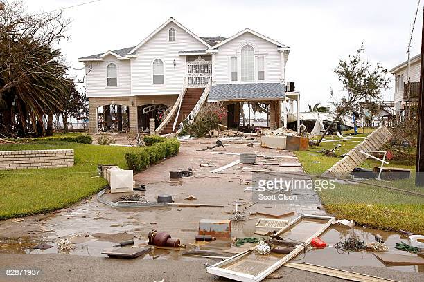 Debris litters the front grounds of a home damaged by Hurricane Ike September 14 2008 in Galveston Texas Ike made landfall yesterday morning at...