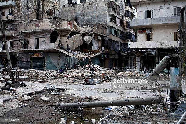 Debris litters the street in front of heavily damaged apartment buildings in the Salahudeen district on November 2 2012 in Aleppo Syria The Shohada...