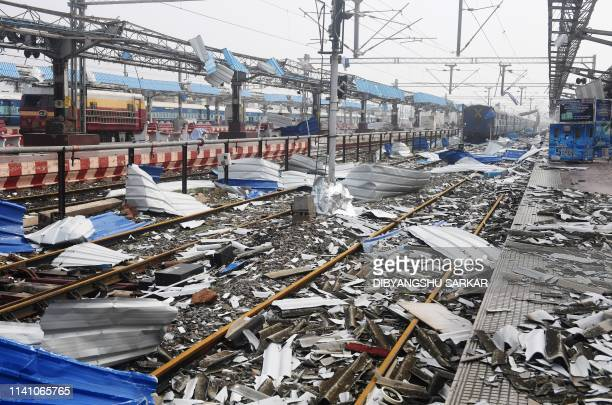TOPSHOT Debris litters the train tracks at the damaged railway station in Puri in the eastern Indian state of Odisha on May 4 after Cyclone Fani...