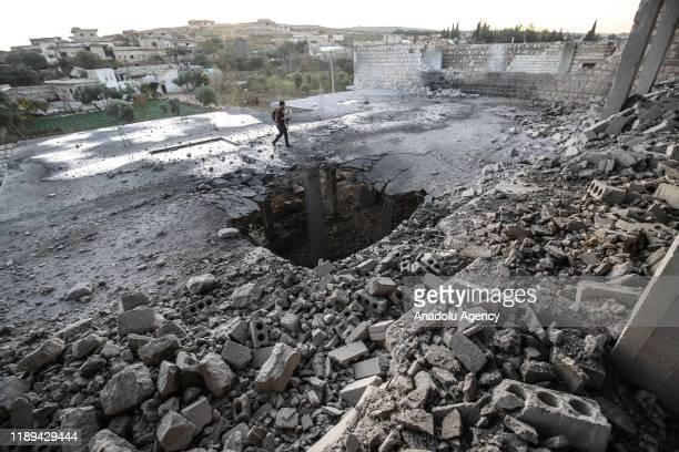 Debris of a building is seen after warplanes belonging to Assad Regime hit Ma'arat al-Nu'man district of Idlib, de-escalation zone, Syria on December...