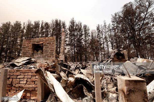 Debris of a burnt house are seen on January 04 2020 in Sarsfield Australia Two people are dead and 28 remain missing following bushfires across the...
