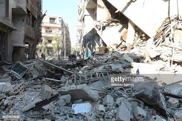 Debris of a collapsed building is seen after Russian army carried out airstrike to eastern Ghouta in Damascus Syria on December 25 2015
