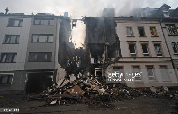 TOPSHOT Debris of a house that has exploded in the night lay in the street in Wuppertal western Germany on June 24 2018 According to the police at...