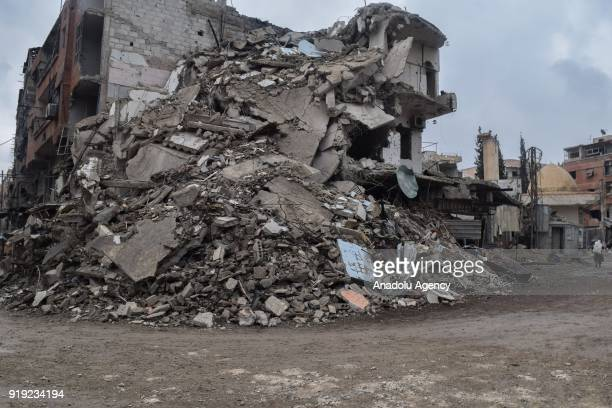 Debris of buildings are seen after Assad Regime's airstrikes and ground attacks to Harasta town in the besieged Eastern Ghouta in Damascus Syria on...