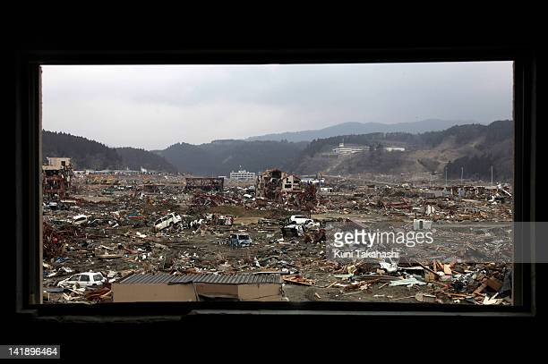 Debris of houses are spread out on March 31 2011 in Minamisanriku Miyagi Japan A Massive tsunami hit northern Japan on March 11 2011 sweeping away...
