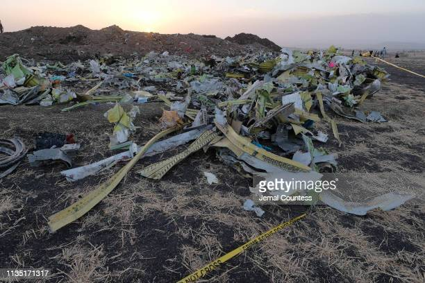 A debris pile sits just outside the impact crater where Ethiopian Airlines Flight ET302 crashed as recovery efforts continue on March 11 2019 in...