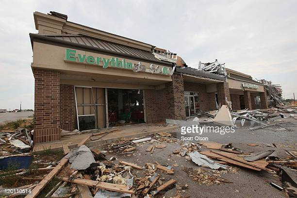 Debris remains scattered around a tornado-damaged strip mall July 30, 2011 in Joplin, Missouri. An estimated 1,200 people in Joplin have filed for...