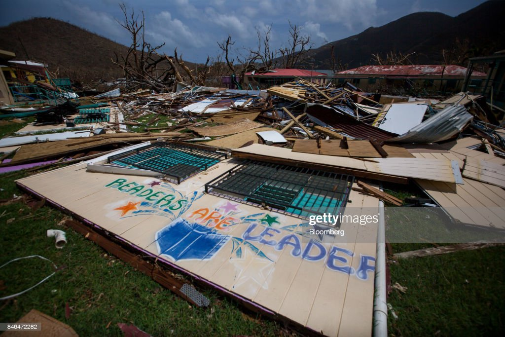 Debris sits in front of a damaged school after Hurricane Irma at Coral Bay in St John, U.S. Virgin Islands, on Tuesday, Sept. 12, 2017. After being struck by Irma last week, the U.S. Virgin Islands couldn't look less like a tourist destination. Many local residents are giving up and getting out after losing everything to the category 5 storm,even as the local authorities in the U.S. territory say they are determined to rebuild the islands. Photographer: Michael Nagle/Bloomberg via Getty Images