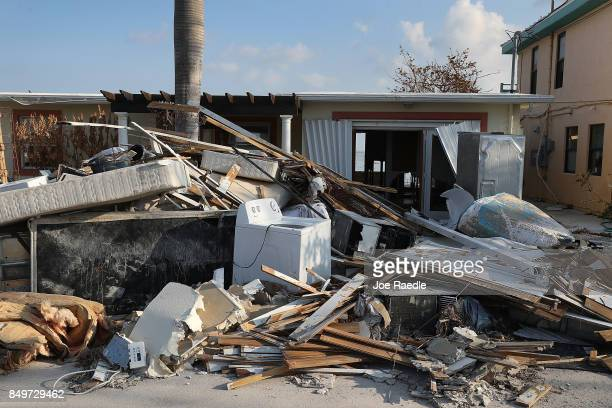 Debris sits in front of a home that was damaged by hurricane Irma on September 19, 2017 in Marathon, Florida. The process of rebuilding has begun as...