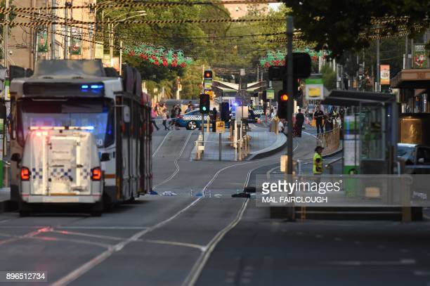 Debris sits in the middle of the road at the scene where a car ran over pedestrians in downtown Melbourne on December 21 2017 The car ploughed into a...