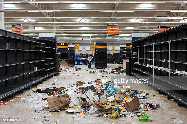 Debris sits inside a Grupo Comercial Chedraui SA store after looting in Veracruz City Mexico on Saturday Jan 7 2017 Mexico's National Association Of...