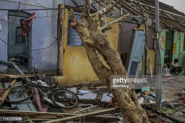 Debris sits outside of a damaged home after Cyclone Fani passed through Puri Odisha India on Saturday May 4 2019 A category 4 storm with strong wind...