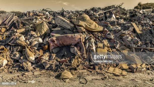 debris wall - landfill stock photos and pictures