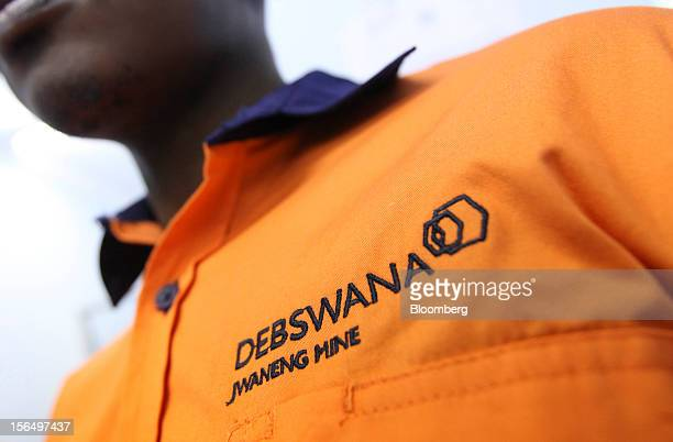 A Debswana logo is seen embroidered on the overalls of a mineworker at the Jwaneng mine operated by the Debswana Diamond Co a joint venture between...