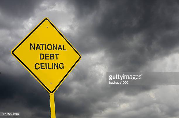 debt ceiling road sign - debt ceiling stock photos and pictures