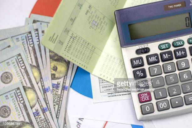debt collection and tax season concept with deadline calendar remind note,coins,banks,calculator on table, background ,time to pay concept - fee stock pictures, royalty-free photos & images